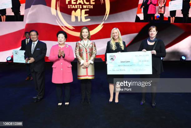 A donation to Union Cyber is presented during Peace Starts With Me concert at Nassau Coliseum on November 12 2018 in Uniondale New York