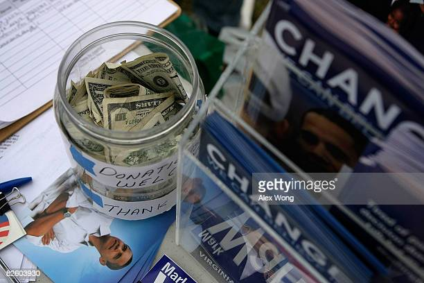 Donations for the Obama Campaign fill a jar as volunteers help to register voters at a weekly farmers market at Kingstowne Town Center August 29 2008...