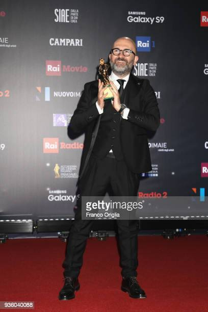 Donato Carrisi poses with the Best New Director Award at the end of the 62nd David Di Donatello awards ceremony on March 21 2018 in Rome Italy