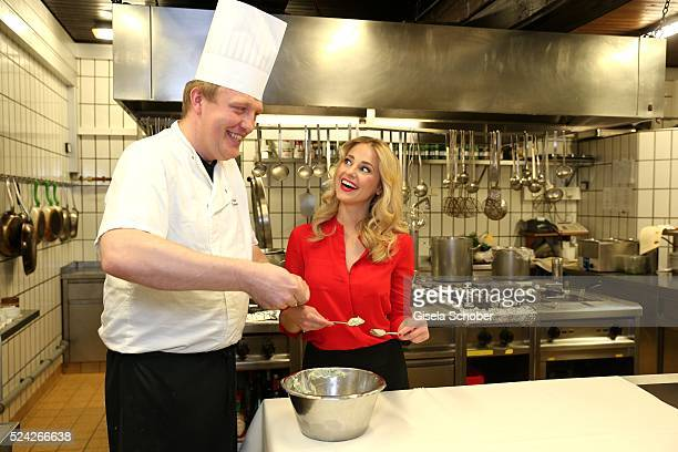 Donau Testimonial Silvia Schneider and cook Alois Grufeneder cook during the 'Genuss am Fluss' cooking event at Hotel 'Donauschlinge Schloegen' on...