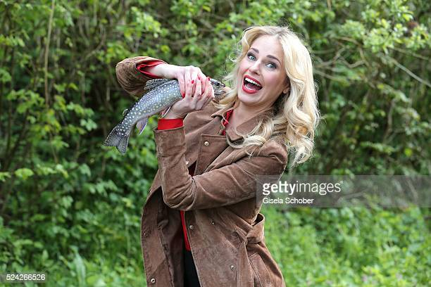 Donau Testimonial Silvia Schneider with a living trout during the 'Genuss am Fluss' cooking event at Hotel 'Donauschlinge Schloegen' on April 25 2016...
