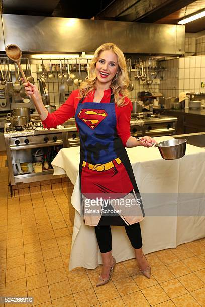 Donau Testimonial Silvia Schneider with a super woman apron during the 'Genuss am Fluss' cooking event at Hotel 'Donauschlinge Schloegen' on April 25...