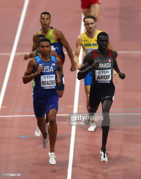 Donavan Brazier of the United States and Marco Arop of Canada compete in the Men's 800 metres heats during day two of 17th IAAF World Athletics...