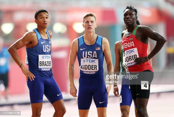 Donavan Brazier of the United States, Brannon Kidder of the United States and Emmanuel Kipkurui Korir of Kenya react after competing in the Men's 800...