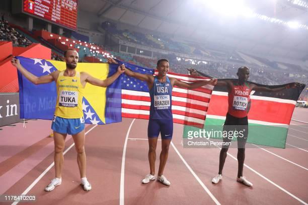 Donavan Brazier of the United States, gold, Amel Tuka of Bosnia and Herzegovina, silver, and Ferguson Cheruiyot Rotich of Kenya, bronze, celebrate...