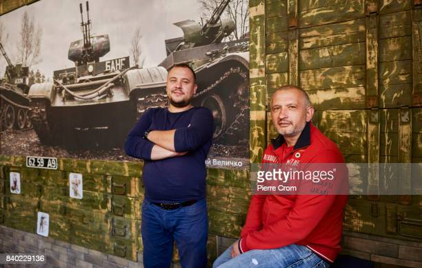 Donbas war veterans Ostap and Yuri pose outside restaurant Patriot on August 28 2017 in Lviv Ukraine Donbas war veterans Ostap and Yuri openened the...
