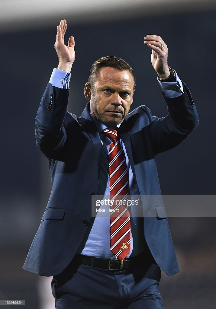 Doncaster manager Paul Dickov applauds the travelling Doncaster fans at the end of the Capital One Cup Third Round match between Fulham and Doncaster Rovers at Craven Cottage on September 23, 2014 in London, England.