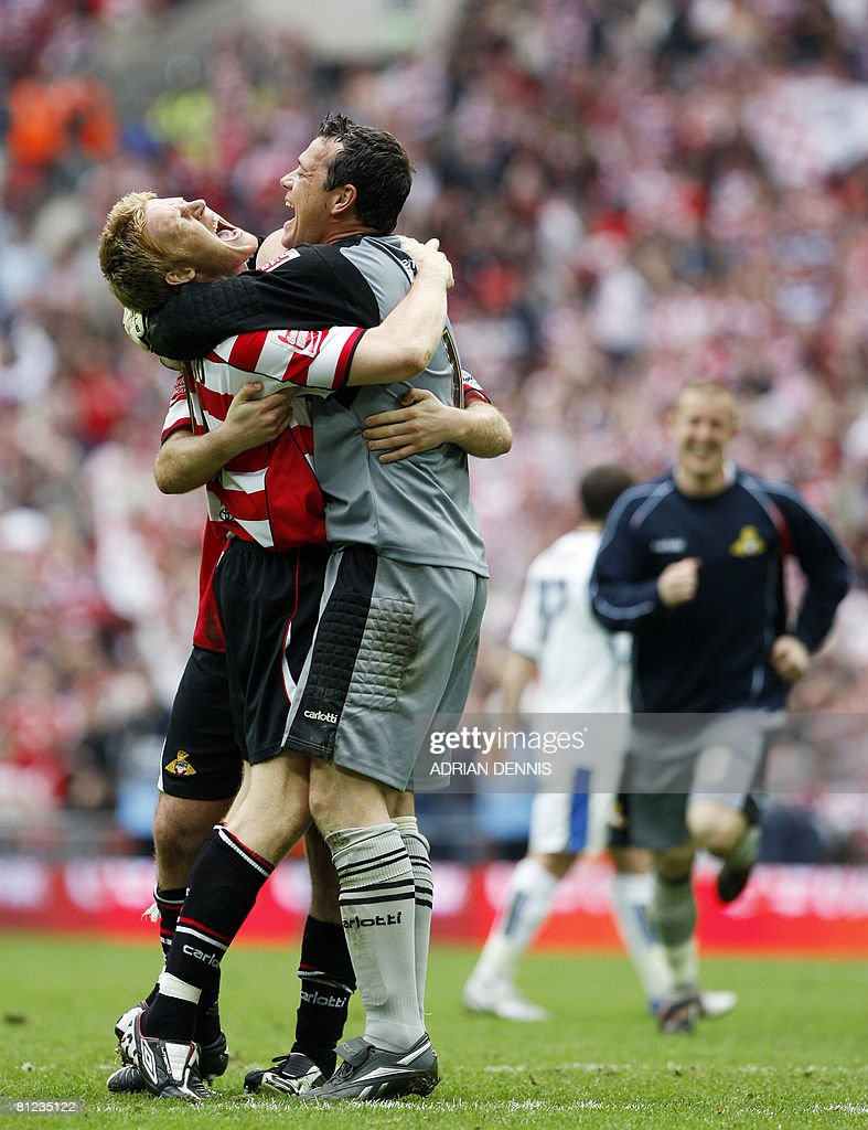 Doncaster Rovers' Adam Lockwood (L) and goalkeeper Neil Sullivan (C) celebrate their victory over Leeds United during the Football League One playoff final football match at Wembley Stadium in London on May 25, 2008. Doncaster won the game 1-0 to secure promotion to the Championship. AFP PHOTO / Adrian Dennis
