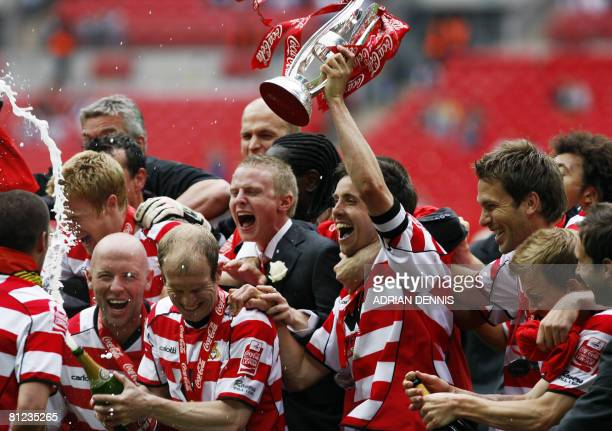 Doncaster Rovers' Captain Brian Stock holds the trophy aloft as they celebrate their victory over Leeds United during the Football League One playoff...