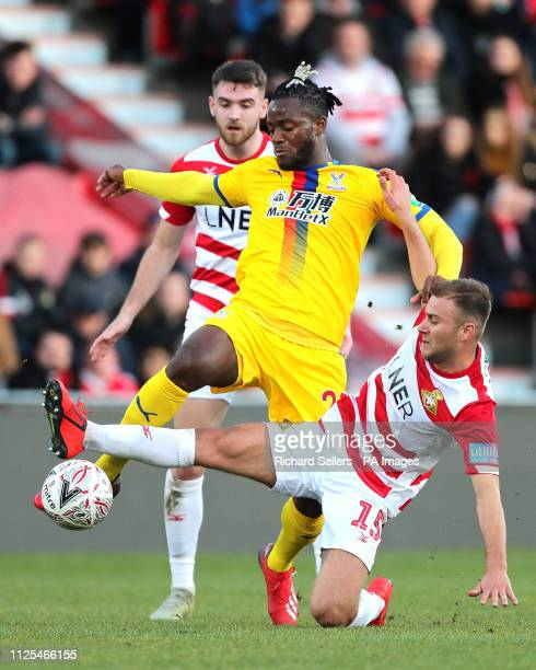 Doncaster Rovers' Herbie Kane slides in on Crystal Palace's Michy Batshuayi during the FA Cup fifth round match at the Keepmoat Stadium Doncaster