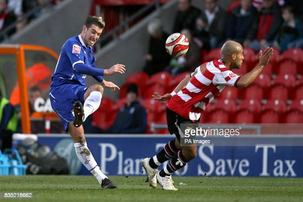 Doncaster Rovers' James Chambers and Birmingham City's Franck Queudrue battle for the ball