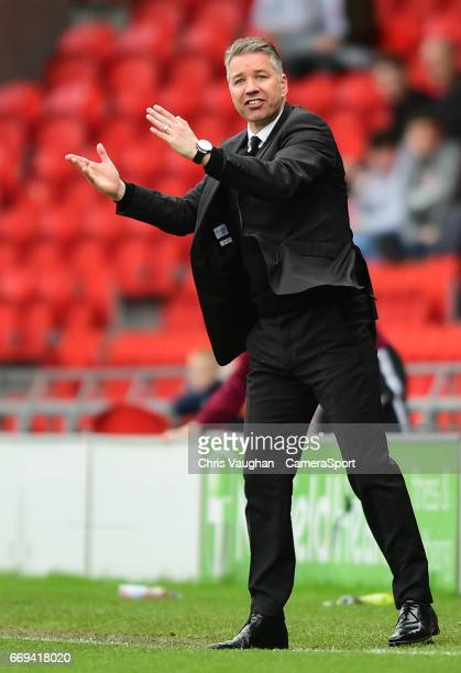 Doncaster Rovers manager Darren Ferguson shouts instructions to his team from the dugout during the Sky Bet League Two match between Doncaster Rovers...