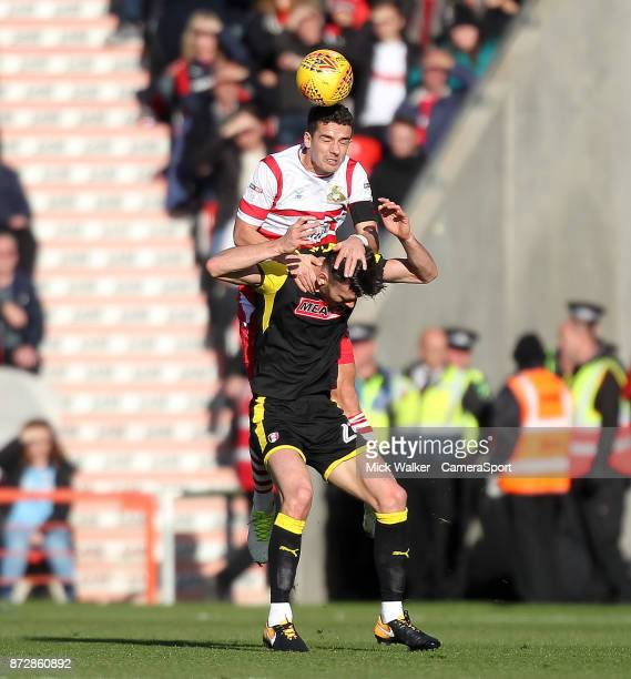 Doncaster Rovers' Mathieu Baudry outjumps Rotherham United's Kieffer Moore during the Sky Bet League One match between Doncaster Rovers and Walsall...