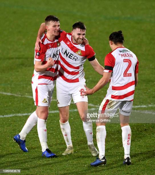 Doncaster Rovers players celebrate following their sides victory in the FA Cup Fourth Round match between Doncaster Rovers and Oldham Athletic at...