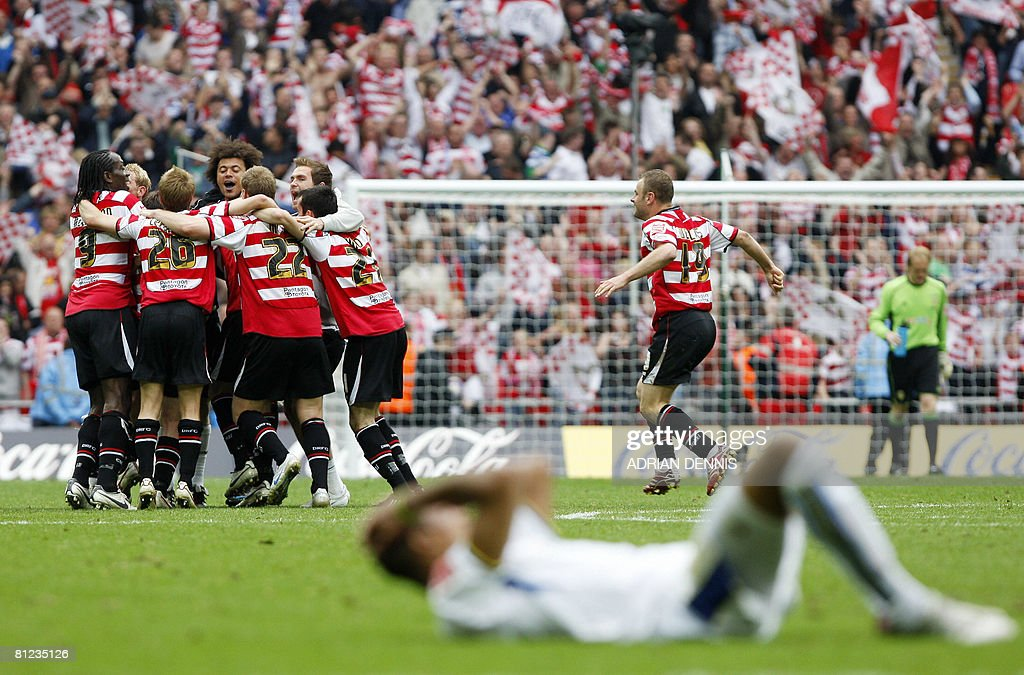 Doncaster Rovers players celebrate their victory over Leeds United during the Football League One playoff final football match at Wembley Stadium in London on May 25, 2008. Doncaster won the game 1-0 to secure promotion to the Championship. AFP PHOTO / Adrian Dennis