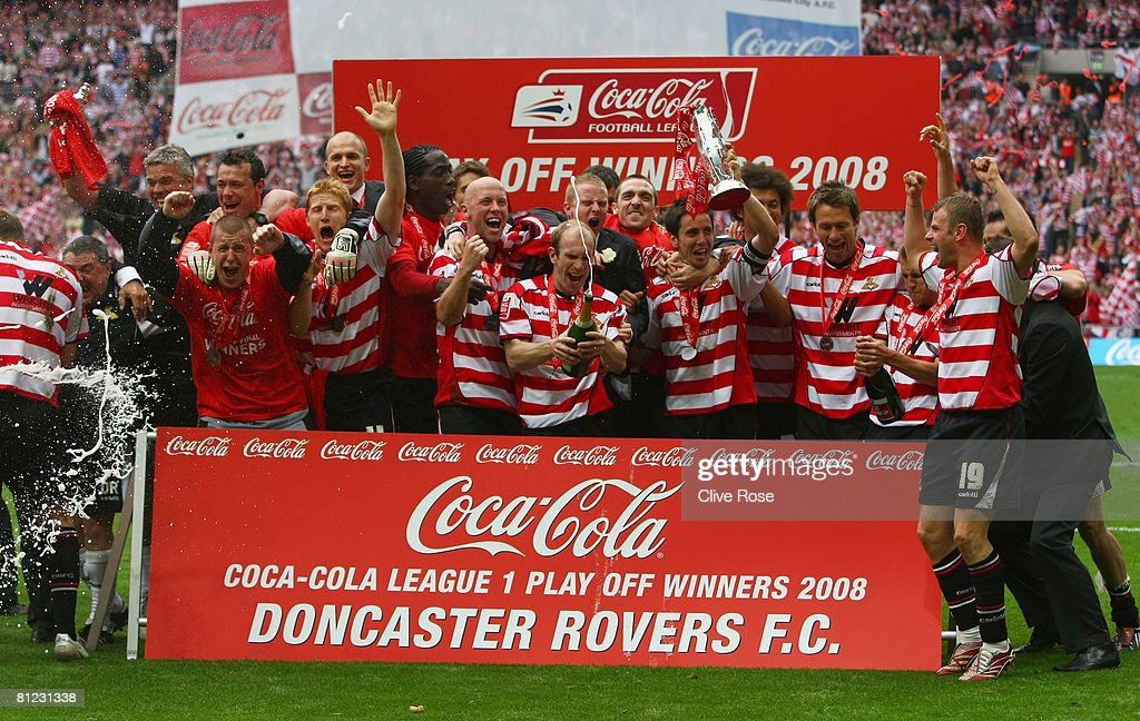 Doncaster Rovers players celebrate victory following the Coca Cola League 1 Playoff Final match between Leeds United and Doncaster Rovers at Wembley Stadium on May 25, 2008 in London, England.