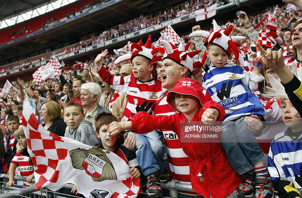 Doncaster Rovers supporters celebrate after beating Leeds United during the Football League One playoff final football match at Wembley Stadium in London on May 25, 2008. Doncaster won the game 1-0. AFP PHOTO / Adrian Dennis