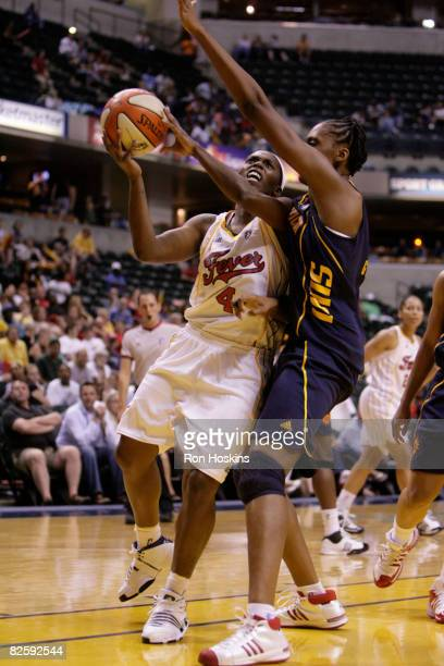 Doneeka Lewis of the Indiana Fever drives on Sandrine Gruda of the Connecticut Sun at Conseco Fieldhouse on August 28 2008 in Indianapolis Indiana...
