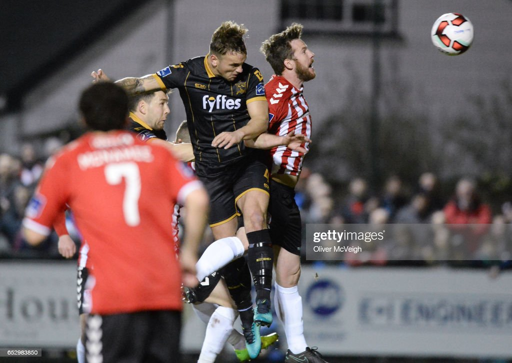 Donegal , Ireland - 13 March 2017; Paddy Barrett of Dundalk in action against Ryan McBride of Derry City during the SSE Airtricity League Premier Division match between Derry City and Dundalk at Maginn Park in Buncrana, Donegal.
