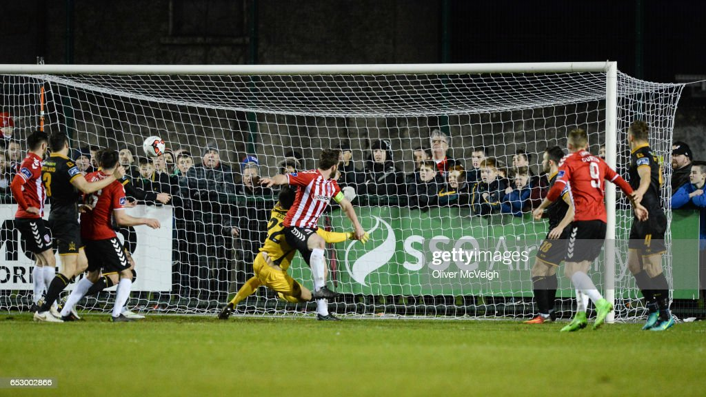 Donegal , Ireland - 13 March 2017; Ryan McBride of Derry City scores his side's third goal despite the challenge of Gabriel Sava of Dundalk during the SSE Airtricity League Premier Division match between Derry City and Dundalk at Maginn Park in Buncrana, Donegal.