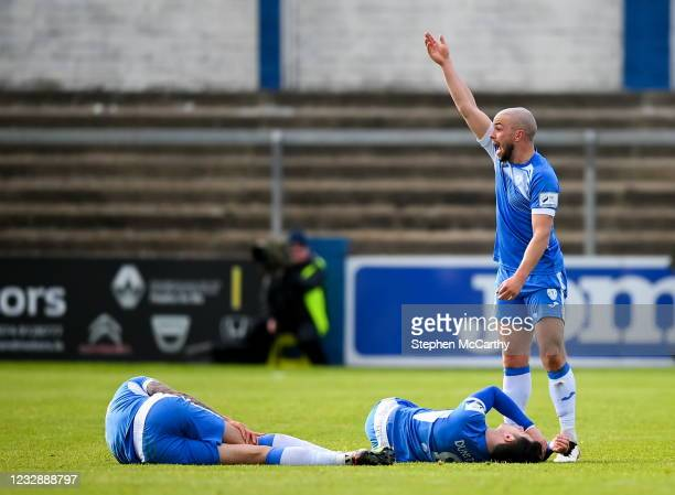 Donegal , Ireland - 14 May 2021; Mark Coyle calls for medical attention for his Finn Harps team-mates Johnny Dunleavy and Adam Foley, left, during...