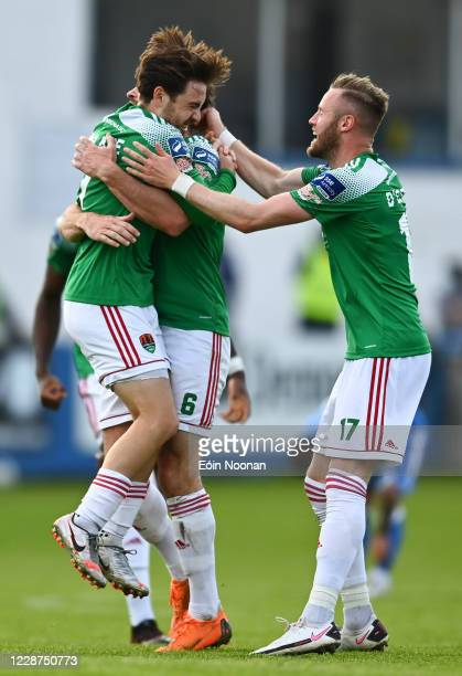Donegal , Ireland - 27 September 2020; Dylan McGlade of Cork City celebrates with team-mates Gearóid Morrissey and Kevin O'Connor, right, after...