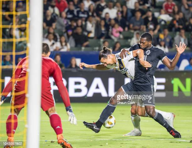 Doneil Henry of Vancouver Whitecaps defends againts Zlatan Ibrahimovic of Los Angeles Galaxy during the Los Angeles Galaxy's MLS match against...