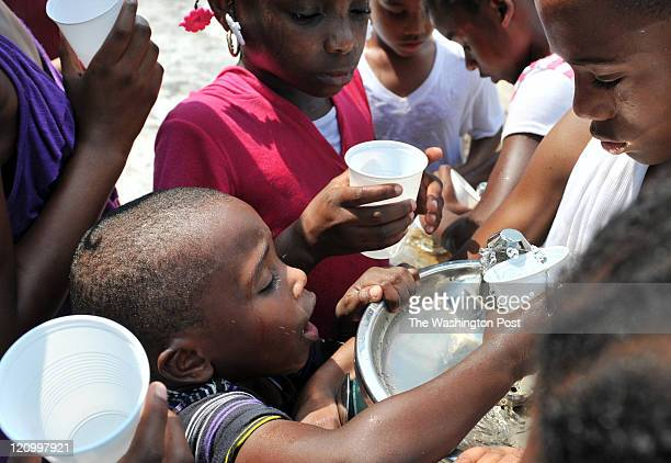 Donell Bolling positions himself to get water during Beacon House field day at Edgewood Playground on July 22 in Washington DC Heat indexes in the...
