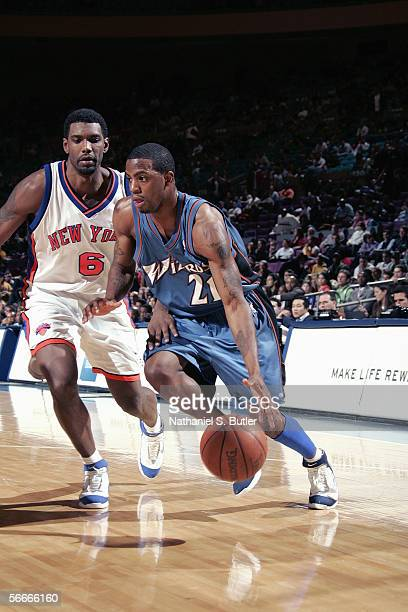 Donell Taylor of the Washington Wizards dribbles against Qyntel Woods of the New York Knicks on January 6 2006 at Madison Square Garden in New York...