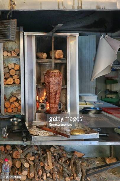doner kebab cooked with wood fire at kemaralti,izmir - emreturanphoto stock pictures, royalty-free photos & images