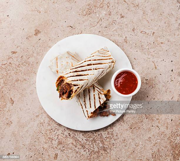 Doner Kebab grilled meat on stone textured background