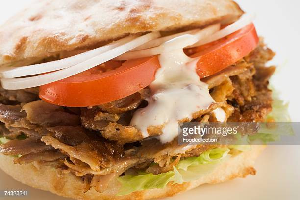 a doner kebab - doner kebab stock photos and pictures