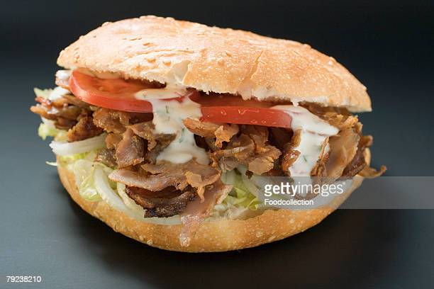 doner kebab with onions, tomatoes and yoghurt sauce - doner kebab stock photos and pictures