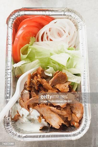 Doner kebab with vegetables in aluminium dish