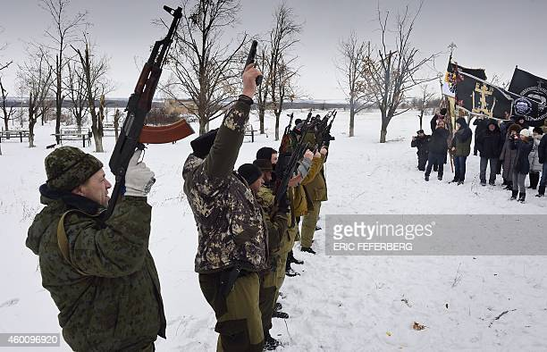 Donestk People's Republic fighters fire in the air on December 7 2014 at the Savur Mogila monument near the eastern Ukrainian city of Snizhnee at the...