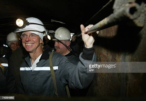 US Ambassador in Ukraine William Taylor smiles as he goes down in a cage during his visit to Belozerskaya coal mine about 125 km from the industrial...
