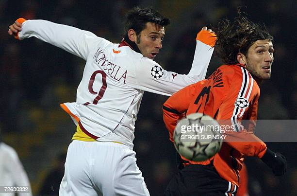 Vincenzo Montella of Roma fights for the ball with Dmitro Chygrynskiy of Shakhtar during theeir UEFA Champion's League Group D football match in...