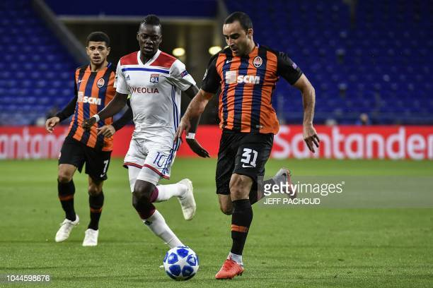 Donetsk's Brazilian defender Ismaily vies with Lyon's Burkinabe forward Bertrand Traore during their UEFA Champions League Group F football match...