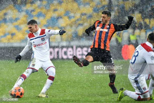 Donetsk's Brazilian forward Júnior Moraes vies for the ball with Lyon's French midfielder Houssem Aouar during the UEFA Champions League Groupe F...