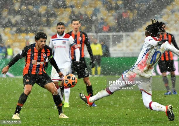 Donetsk's Brazilian midfielder Taison and Bertrand Lyon's Burkinabe forward Bertrand Traore vie for the ball during the UEFA Champions League Groupe...