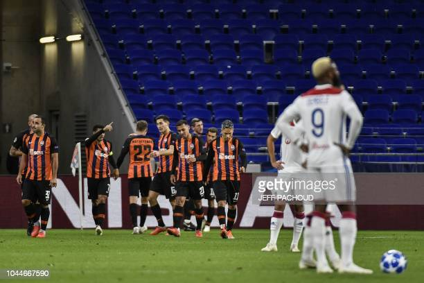 Donetsk's players celebrate their second goal during their UEFA Champions League Group F football match Olympique Lyonnais vs FC Shakhtar Donetsk at...