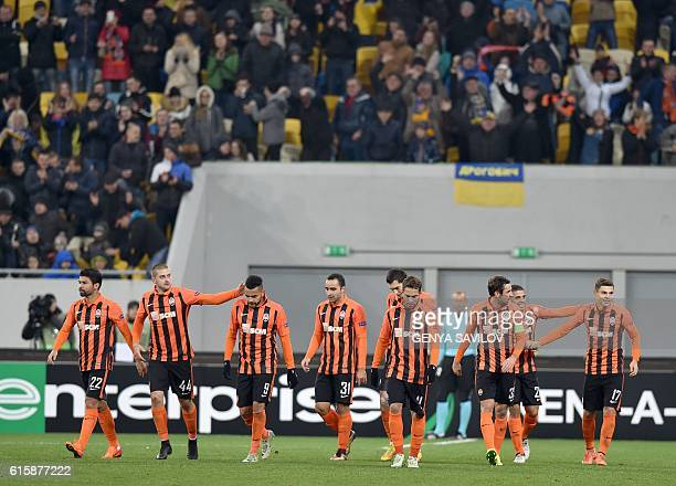 Donetsk's supporters react after scoring during the Europa League group H football match between Shakhtar Donetsk and KAA Gent at the Arena Lviv...