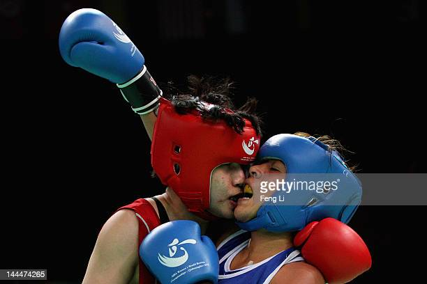 Dong Cheng of China fights against Erika Cruz Hernandez of Mexico in the Women's 60kg preliminary match during the AIBA Women's World Boxing...