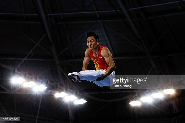 Dong Dong of China competes in the Gymnastics Trampoline Men's Final in day seven of the 2014 Asian Games at Namdong Gymnasium on September 26 2014...