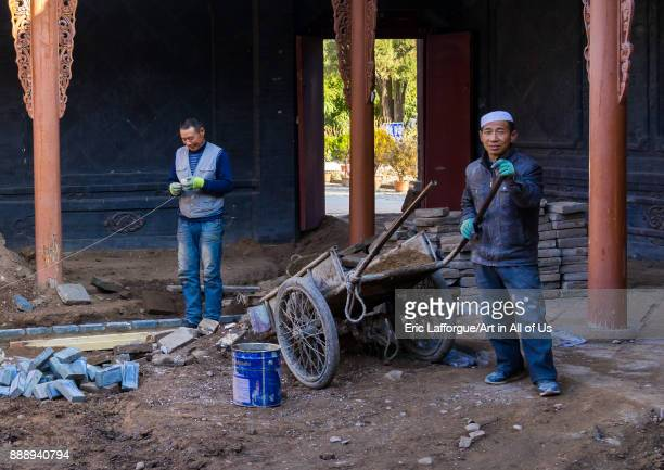 Dong Gong Guan house being renovated by chinese workers Gansu province Linxia China on November 1 2017 in Linxia China