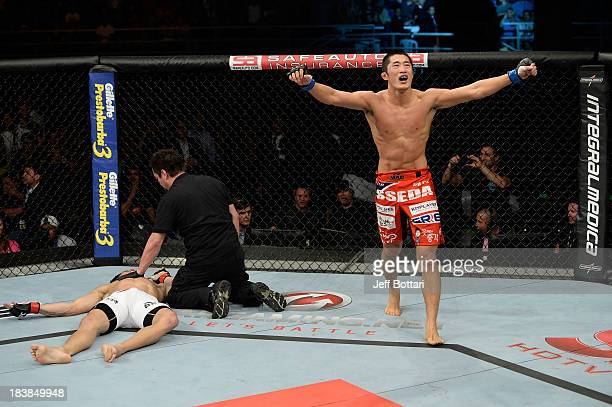 Dong Hyun Kim celebrates after knocking out Erick Silva in their welterweight bout during the UFC Fight Night event at the Ginasio Jose Correa on...