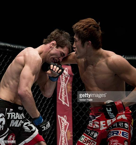 Dong Hyun Kim of South Korea and John Hathaway of England fight in their welterweight bout during the UFC Fight Night at the Cotai Arena on March 1,...