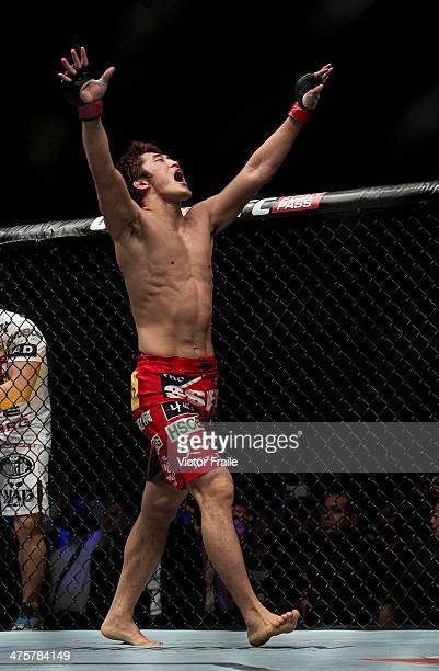 Dong Hyun Kim of South Korea celebrates his knockout against John Hathaway of England in their welterweight bout during the UFC Fight Night at the...