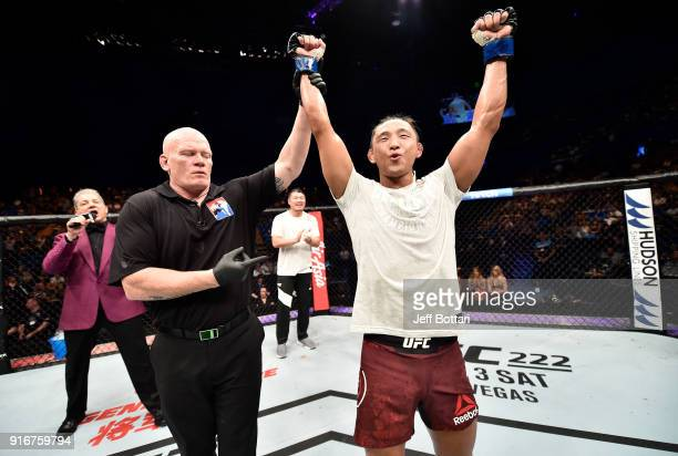 Dong Hyun Kim of South Korea celebrates his victory over Damien Brown of Australia in their lightweight bout during the UFC 221 event at Perth Arena...