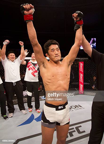 Dong Hyun Kim of South Korea has his hand raised after his win over Dominic Waters of the United States of America in their welterweight bout during...